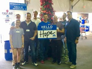 Ed Ellsasser volunteers at the Metropolitan Ministries Holiday Tent with friends from the CEO Council. 120 families an hour came by for food and toys!