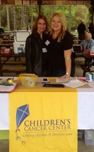 Children's Cancer Center Tampa Bay Dina and Kimberly volunteering on Friday to raise money for the Children's Cancer Center at Tampa Bay Sporting Clays & Archery.